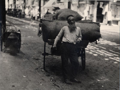 Untitled (New York Scene, Man with Wagon)