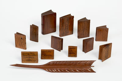 Twelve small carved wooden books