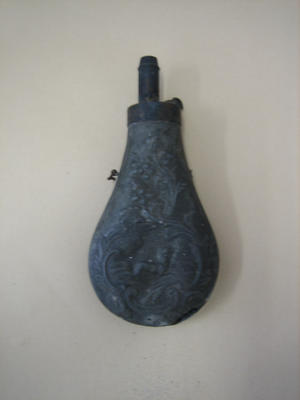 Embossed metal powder flask