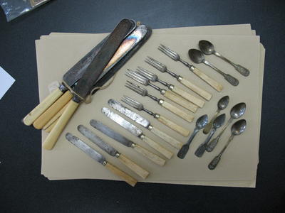 Set of silverware with ivory handles