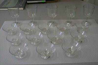 12 molded glass stemmed sauce dishes and 5 molded glass stemmed goblets