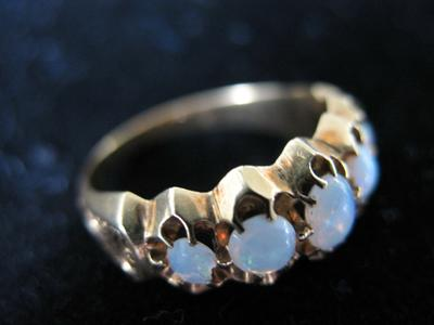 Woman's Gold and Opal Ring