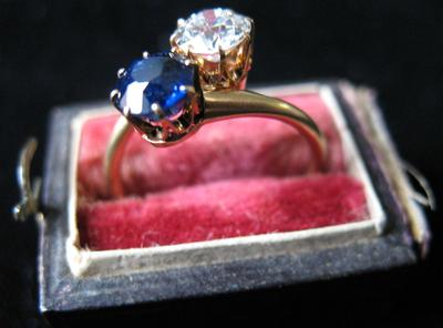 Woman's Gold, Diamond and Sapphire Bypass Ring