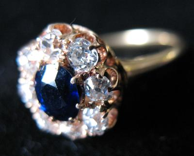 Woman's Gold, Diamond and Sapphire Cluster Ring