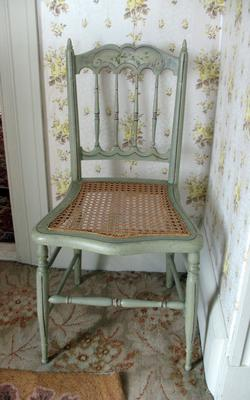 Green Chair with Wicker Seat
