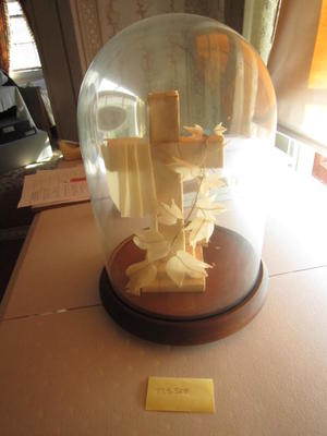 Wooden Cross Under Glass Dome