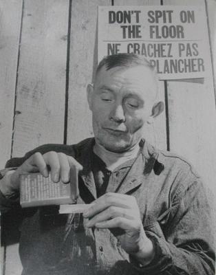 Untitled (Man Rolling Cigarette)