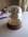 Needle Sampler Framed in Golden Holder Under Glass Dome